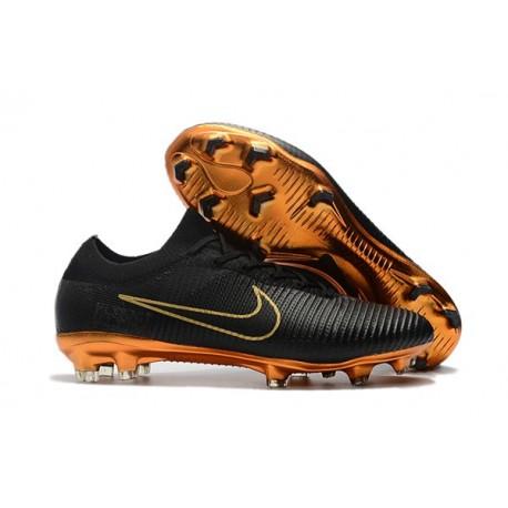 a6aca3e119b Nike Mercurial Vapor Flyknit Ultra FG Soccer Cleats for Men Black Gold